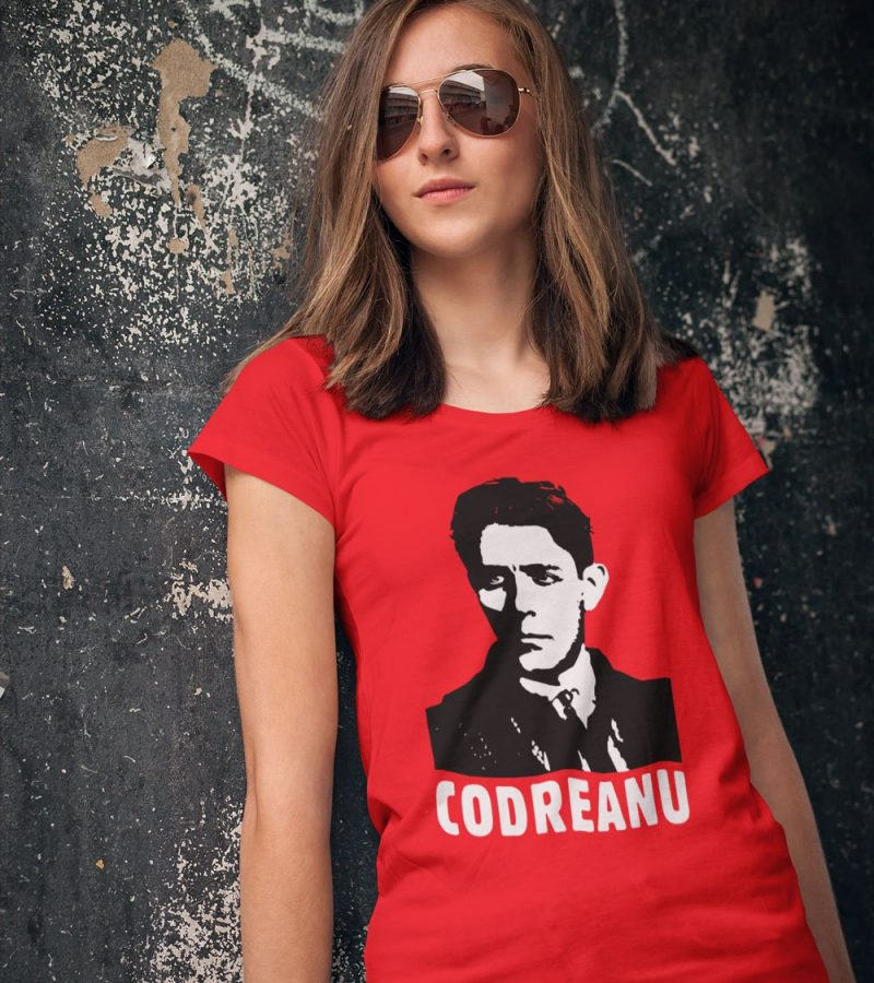 Codreanu-a-young-woman-wearing-a-t-shirt-and-leaning-against-an-urban-wall_INSTA